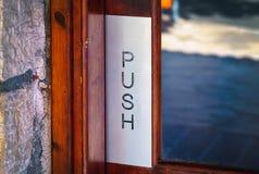 Wooden door with world Push. Stock Photos