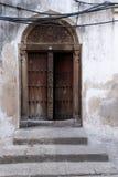 Wooden door, zanzibar. Traditional wooden ornate door in stone town, zanzibar, tanzania Royalty Free Stock Image