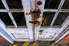 Wooden doors. Old, wooden doors with padlock royalty free stock images
