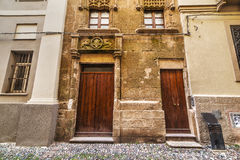 Wooden doors in Alghero old town Royalty Free Stock Photos