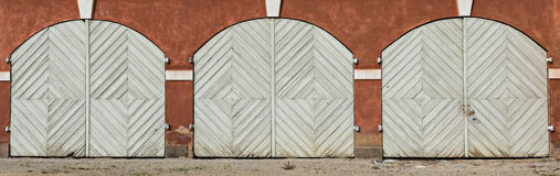 Wooden doors of ancient stable Stock Images