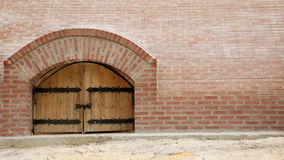 Wooden doors with brick wall Stock Images