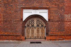 Wooden doors in brick wall. Big Wooden doors in red brick wall Royalty Free Stock Photos
