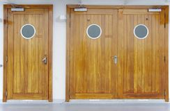 Wooden doors with a circle window Royalty Free Stock Images