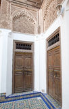 Wooden doors in a corner of a Moroccan palace Royalty Free Stock Images