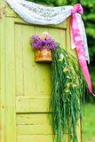 Wooden doors decorated with flowers. Antique wooden doors decorated with flowers in the garden stock photos