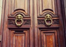 Wooden doors at the entrance to the house in Europe stock images
