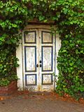 Wooden doors in garden Royalty Free Stock Photo