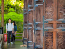 Wooden doors in Kyoto temple with people in background. Wooden doors in Kyoto, Japan temple with people in background Royalty Free Stock Images