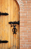 Wooden doors with lock and brick Stock Photo