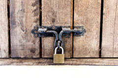 Wooden doors locked with padlock Royalty Free Stock Photos