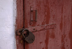 Wooden doors locked padlock Royalty Free Stock Photos