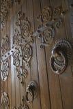Wooden doors with metalwork. stock photo