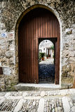 Wooden doors / path through the old city Royalty Free Stock Images