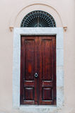 Wooden doors on the pink wall Royalty Free Stock Images