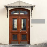 Wooden doors with signage Stock Photos