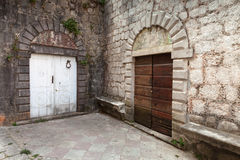 Wooden doors on the street of Perast town Stock Photography