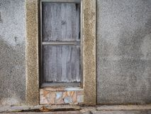 Wooden doors on the wall of cement. Wooden door on the wall of cement Stock Photography