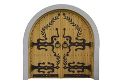 Wooden doors with wrought iron patterns royalty free stock photo