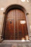 Wooden doorway. Arched wooden doorway with metal detailing stock photo