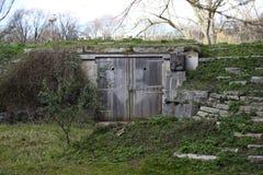 Wooden doorway in hillside Stock Photography