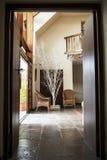 Wooden Doorway. A wooden doorway leading to lounge area with floor tiles and wood features Stock Photo