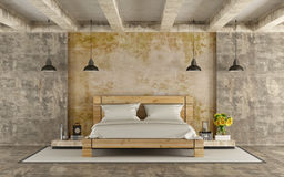 Wooden double bed in grunge room Stock Photos