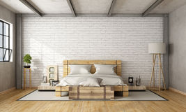 Wooden double bed in loft Stock Images