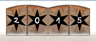 Wooden double door with black stars - new years 2015 Stock Images