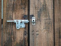 Wooden double door of entrance with an open metal latch lock royalty free stock image