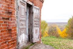 A wooden double door in an old abandoned house. One door leaf is open. Rukavishnikov manor in the village of Podviazye. Bogorodsky District royalty free stock photos