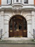 Wooden double doors. Entrance to office builiding or school Royalty Free Stock Images
