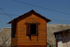 Wooden dovecote brown color with shutters Stock Images
