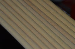 Wooden dowels. Diagonally lined together Stock Photos