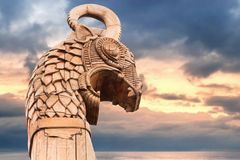 Wooden dragon on the bow of Viking ship. Carved wooden dragon on the bow of Viking ship above morning sky and sea Stock Photo