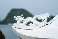 Wooden dragon decorate a ship in Halong Bay Stock Image