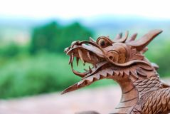 Wooden dragon face royalty free stock photo