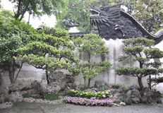 Wooden Dragon sculpture on the top of the wall in the famous Yu Garden on downtown of Shanghai. Wooden Dragon sculpture on the top of the wall from Yu Garden on royalty free stock photos