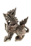 Wooden dragon statuette Stock Images