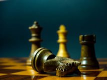 Wooden draught pieces on a wooden chessboard Royalty Free Stock Photos