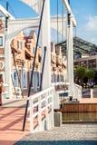 Wooden drawbridge at european city on sunny day Stock Photos
