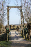 Wooden drawbridge in nature with willows Stock Photography