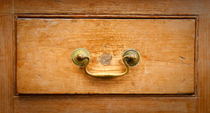 Wooden drawer. An antique wooden drawer close up Royalty Free Stock Photography