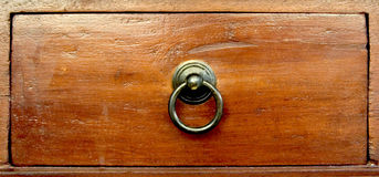 Wooden Drawer. Closeup of a wooden coffee table drawer with a metal ring Royalty Free Stock Photo