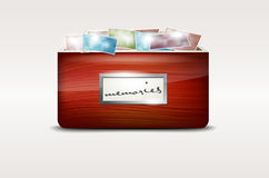 Wooden drawer with abstract photos Stock Image