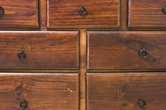 Wooden drawers of a dresser Royalty Free Stock Photo