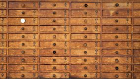 Wooden drawers at a temple. stock photos