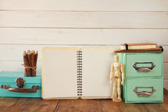 Free Wooden Drawing Model, Colorful Pencils And Open Notebook Royalty Free Stock Photography - 76397307