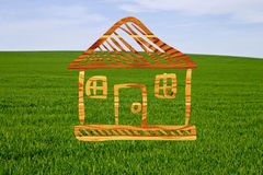 Wooden drawn house on a background of grass Royalty Free Stock Photo