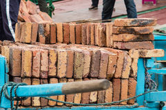 Wooden Dray with Bricks. Royalty Free Stock Images